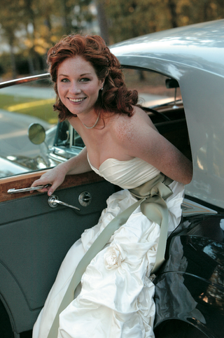 bride-in-strapless-wedding-dress-getting-out-of-classic-wedding-car