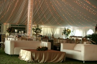 white-couches-and-gold-table-under-ivory-tent-with-twinkle-lights
