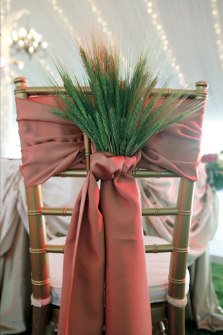 gold-chair-tied-with-red-sash-and-dried-green-barley-and-wheat
