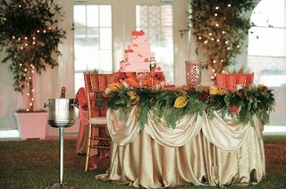 gold-linen-covered-couples-table-with-greenery-and-fall-leaves
