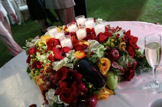 candles-on-top-of-fruit-and-flower-centerpiece