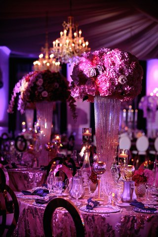 wedding-reception-centerpiece-crystal-riser-candle-votives-hot-pink-purple-flowers