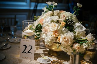 wedding-reception-gold-vessel-vase-white-peach-flowers-greenery-table-number-calligraphy-gold-detail