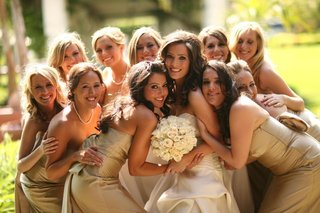 bride-posing-with-bridesmaids-outside