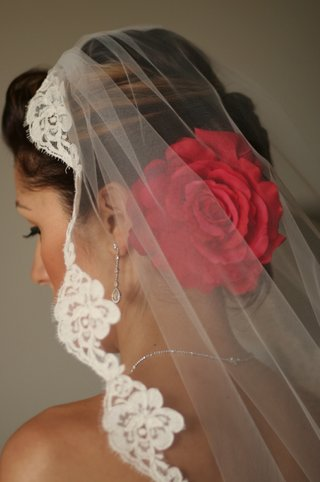 brides-mantilla-veil-and-red-flower-hair-accessories