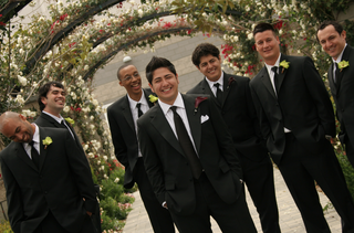 groom-with-six-groomsmen-under-flower-archways
