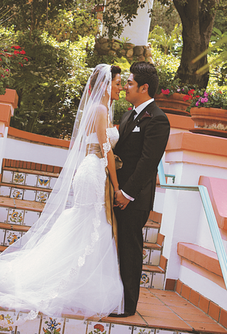 bride-and-groom-on-steps-of-rancho-las-lomas-hacienda-wedding-venue