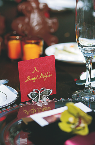 red-and-gold-escort-card-with-silver-butterfly-place-card-holder