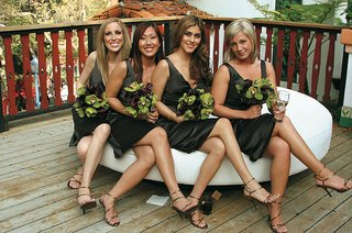 four-bridesmaids-on-ottoman-in-brown-short-dresses-and-matching-bouquets