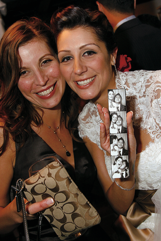 bride-and-maid-of-honor-pose-with-photobooth-picture