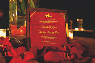 red-wedding-invitation-with-gold-lettering-and-butterfly-motif