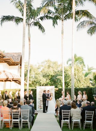 garden-wedding-ceremony-with-a-frame-of-flowers-at-the-altar