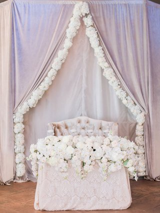 wedding-reception-drapery-with-flower-border-over-sweetheart-table-lace-tablecloth-with-white-flower