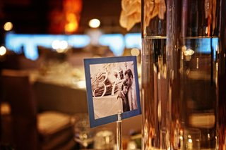 wedding-table-numbers-printed-on-sepia-tone-photos-of-the-couple