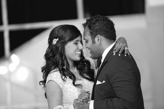 black-and-white-photo-of-a-bride-and-groom-dancing