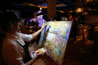 wedding-reception-with-a-painter-painting-a-the-celebration-as-it-was-taking-place