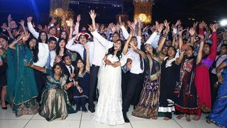 indian-bride-and-groom-celebrate-with-guests-at-reception