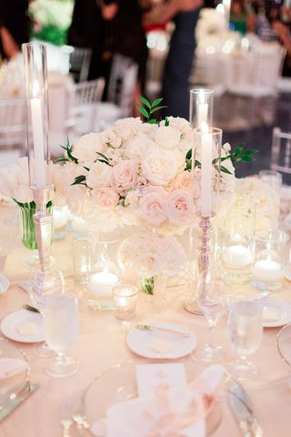blush-and-ivory-wedding-reception-with-small-arrangement-of-roses-and-tapered-candles
