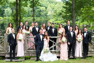 wedding-party-in-front-of-lake-cedar-lakes-estate-new-york-venue-summer-camp-feel-mismatch-dresses