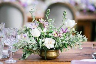 wedding-reception-wood-table-gold-vase-vessel-bowl-white-flower-purple-flowers-greenery-cut-crystal
