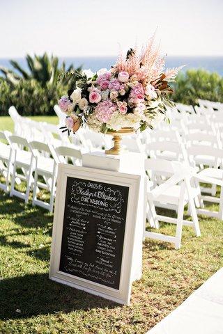 wedding-party-ceremony-sign-blackboard-outdoor-wedding-pacific-ocean-program-chalk