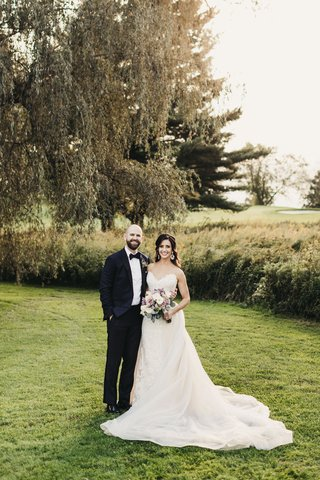 wedding-portrait-with-bride-in-nicole-spose-lace-dress-in-overskirt-groom-in-midnight-blue-tux