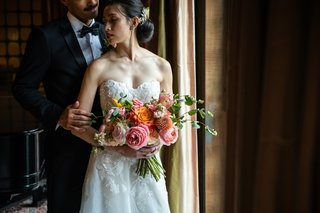 bridal-bouquet-with-dahlias-roses-and-peonies-in-orange-and-pink-peachy-hues