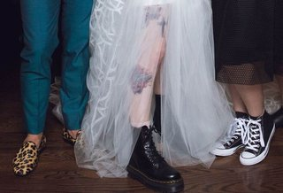 hayley-williams-of-paramore-shows-off-her-doc-martens-and-tattoos-in-her-vera-wang-wedding-dress