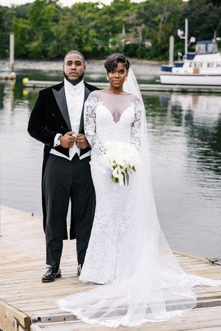 bride-in-illusion-wedding-dress-long-veil-sheer-long-sleeves-updo-groom-in-long-tail-tuxedo