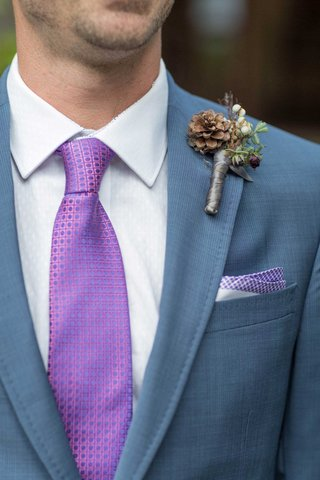 grooms-blue-suit-purple-tie-pocket-square-rustic-boutonniere-patterns-greenery