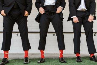 groomsmen-in-tuxedo-showing-red-socks