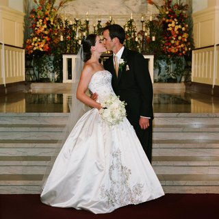 bride-in-reem-acra-ball-gown-and-groom-kiss