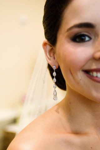 diamond-drop-earrings-on-bride