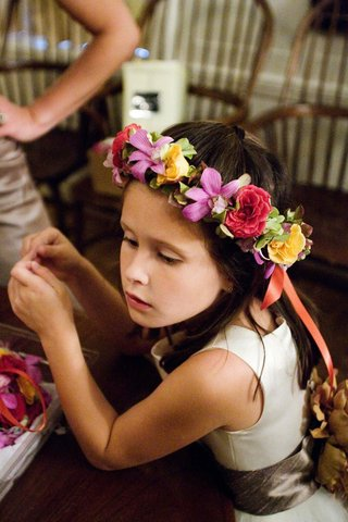 colorful-flower-crown-on-young-brunette-flower-girl
