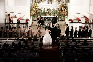 bride-and-groom-at-ceremony-altar-in-church