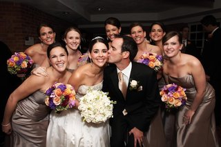 bride-and-groom-with-bridesmaids-at-reception