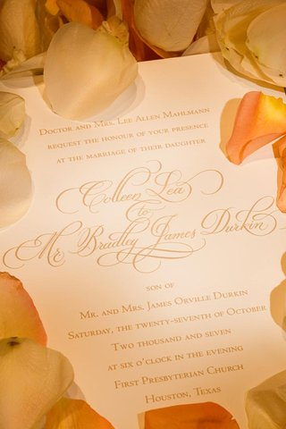 gold-script-wedding-invitation-with-orange-rose-petals