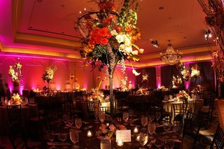 pink-lighting-at-ballroom-wedding-with-tall-centerpieces
