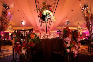 sweetheart-table-with-chairs-covered-in-flowers