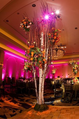 tall-tree-with-candles-and-flowers-on-dance-floor