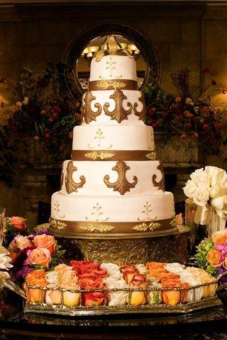gold-fleur-de-lis-wedding-cake-with-gold-cake-topper