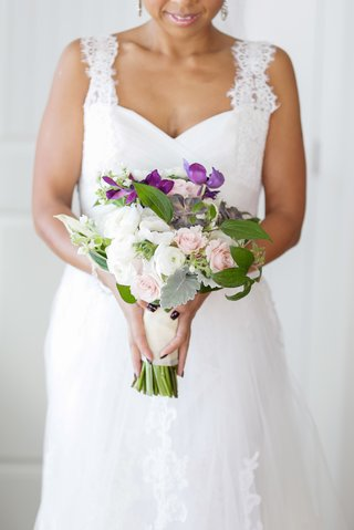 african-american-bride-carries-white-and-purple-bouquet
