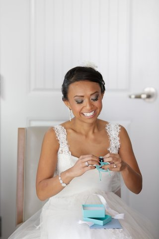 bride-crying-as-she-opens-tiffany-co-gift-from-groom