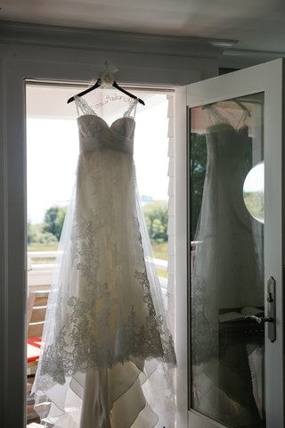 pronovias-wedding-dress-on-custom-hanger-in-doorway
