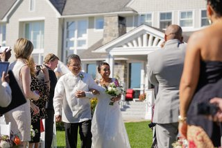 bride-walking-down-grass-aisle-with-father-of-bride