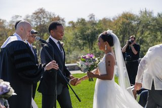 bride-and-groom-hold-hands-at-inn-ceremony