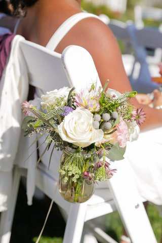 mason-jar-vase-on-white-chair-with-fresh-flowers