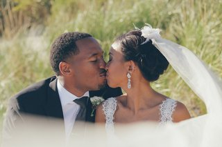african-american-and-filipino-bride-and-groom-kissing