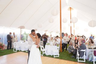 bride-and-groom-dance-under-white-tent-with-paper-lanterns