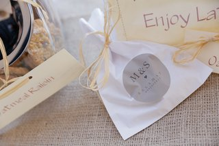 white-take-home-bags-with-custom-grey-wedding-sticker